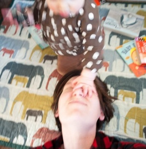 Candid Pic of the Author Having Her Face Smooshed by a Small Human