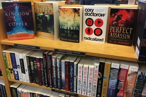 Bookshelf with prominent SFF titles face-out